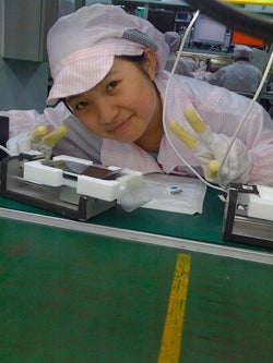 Phew: Cute iPhone Factory Girl Didn't Get Fired