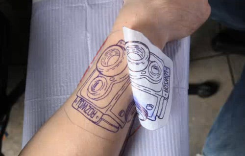 Camera Tattood in Time Lapse (by Another Camera)