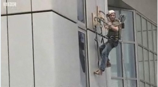 British Man Climbs Up Side of Building Using DIY Vacuum Gloves