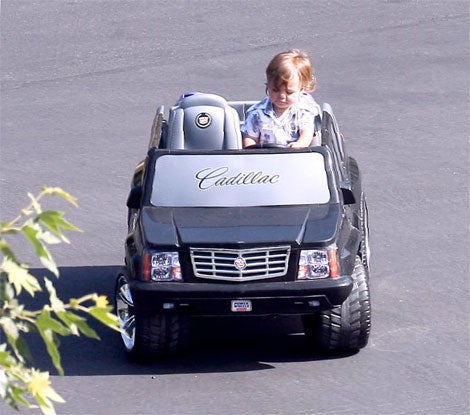 Your Turn To Judge: Whose Kid Is Driving A Cadillac Escalade?