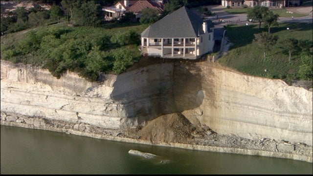 Crumbling Cliff to Send Giant Lake House to Watery Grave