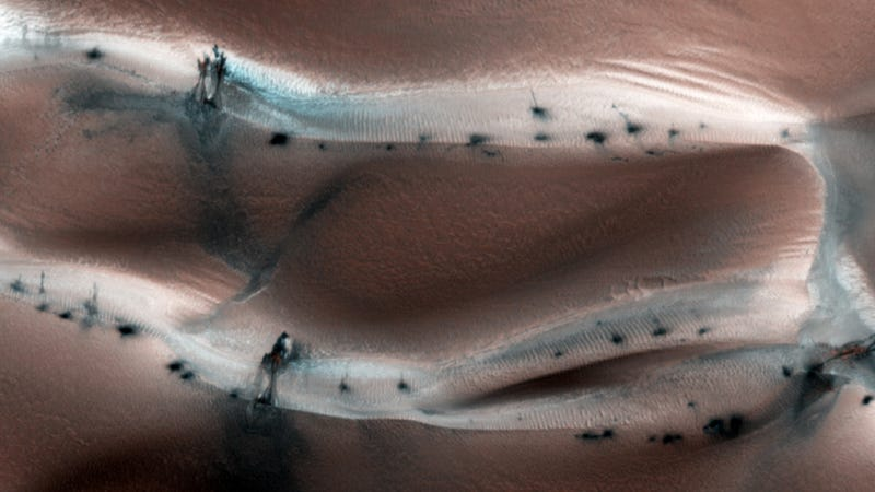 What are these mysterious black splotches on the surface of Mars?