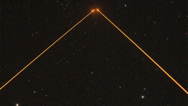 Observatory's twin lasers beam into space