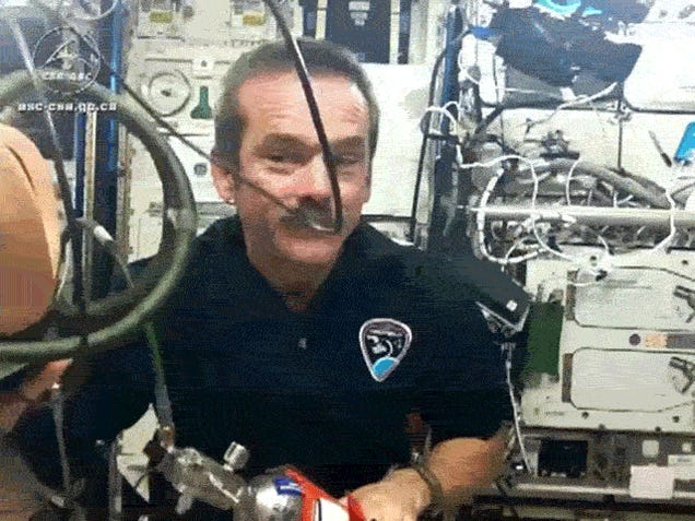 Watch ISS commander Chris Hadfield play with gas masks in space