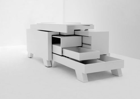 Transformer Shelf Hides Your Stuff, Fauns In Its Puzzling Pockets