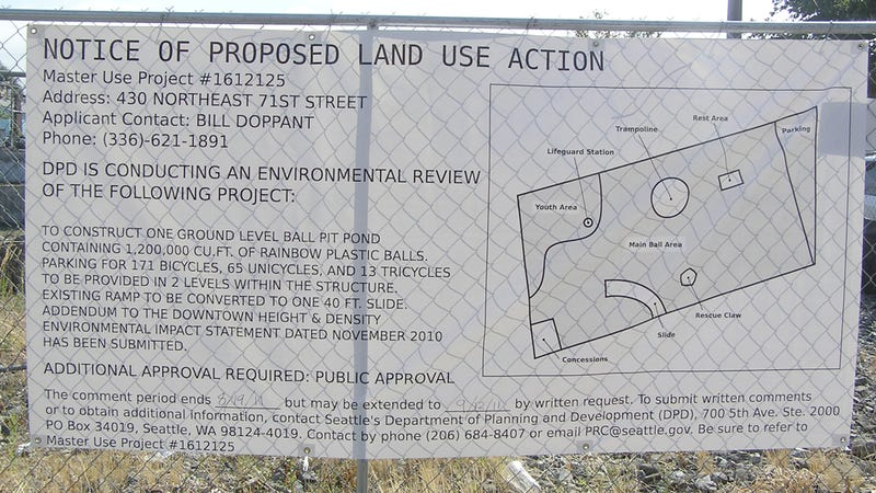 Land use sign in Seattle promises the construction of a giant ball pit