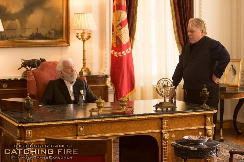 Effie Trinket Leads Katniss and Peeta to Uncertain Death
