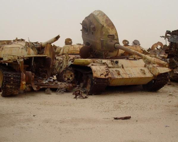 Gloomy tank graveyards hold the rusting bones of war