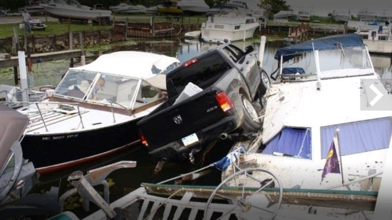 This Pickup Driver Screwed Up A Donut And Landed On Top Of Two Boats