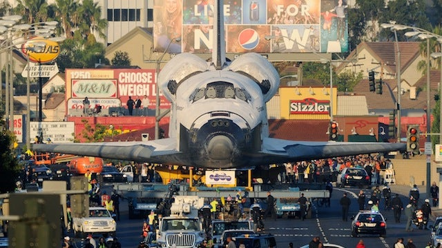 Space Shuttle Endeavour takes its final trip through the streets of Los Angeles