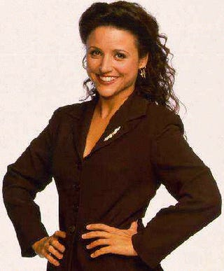 The 90's Revival Turns Elaine Into A Fashion Muse