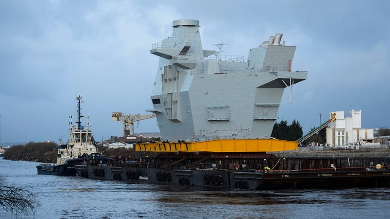 The Graceful Voyage of a Mountain-Sized Section of Aircraft Carrier