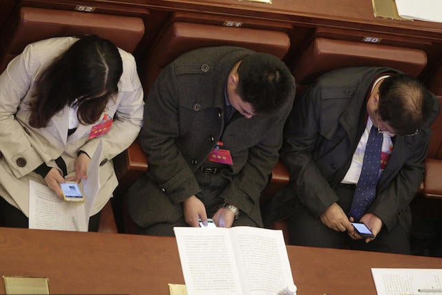 Chinese Politicians Ordered To Stop Playing With Their Phones