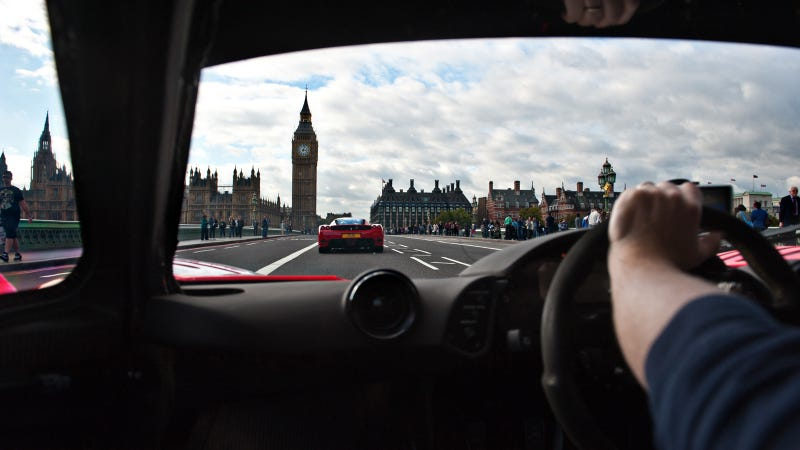 Your ridiculously cool McLaren F1 chasing Enzo Wallpaper is here