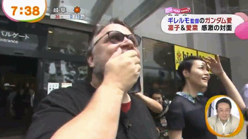 Here's Guillermo Del Toro Looking at a Giant Gundam