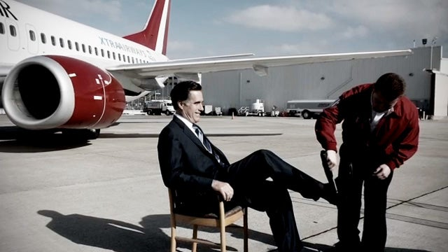 What Is This Proletarian Doing to Mitt Romney's Feet?