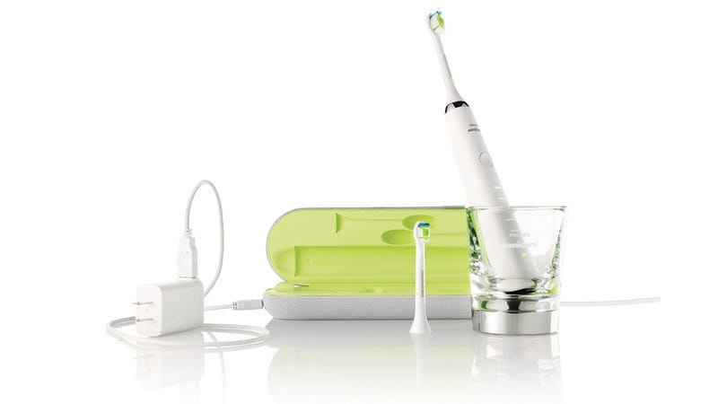 A Philips Electric Toothbrush with a Plug-In Drinking Glass