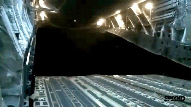 Crazy video: Heavy military trucks being dropped from a plane