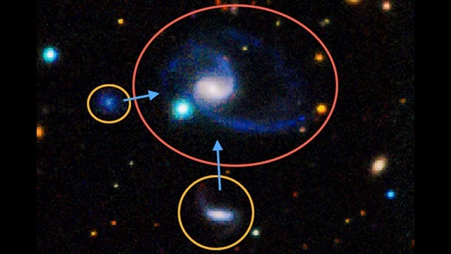 Astronomers discover Milky Way's twin, Magellanic Clouds and all