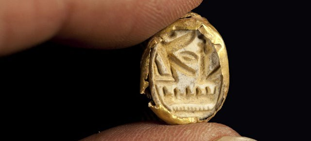 Archeologists unearth rare Egyptian sarcophagus and gold seal in Israel