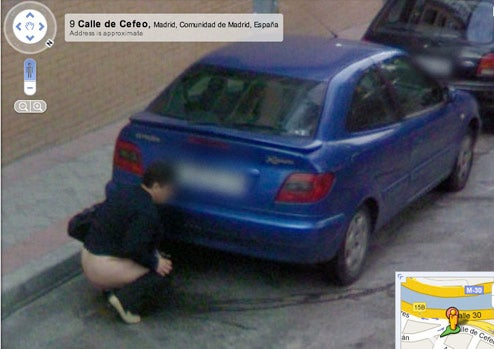 Google Street View Captures Man/Woman Peeing In the Street