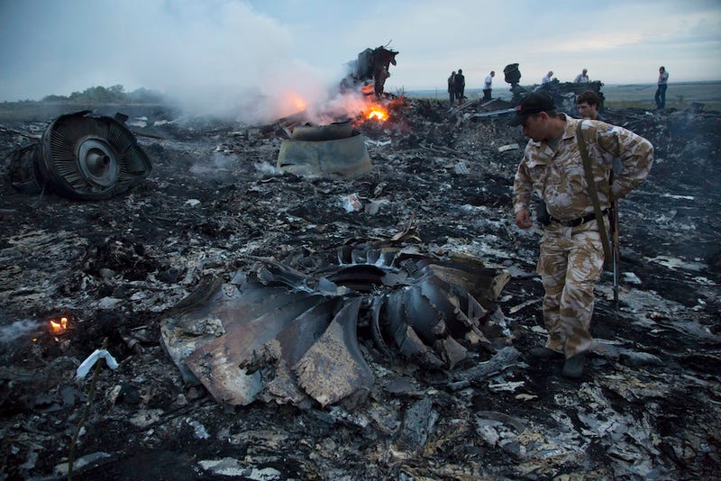 Malaysia Airlines Passenger Jet Downed by Missile Over Ukraine, 298 Dead
