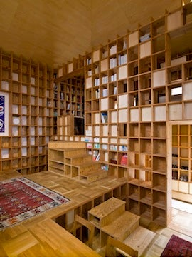 A House Made from Bookshelves Is So Much Better Than a House Made from E-Books