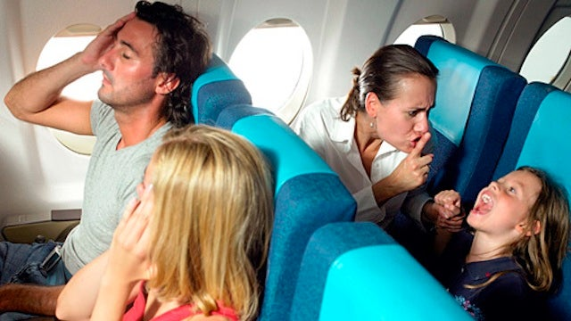Whisper to an Upset Child to Quiet Down an In-Flight Tantrum