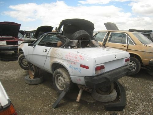 Pair-O-Triumphs Down On The Junkyard