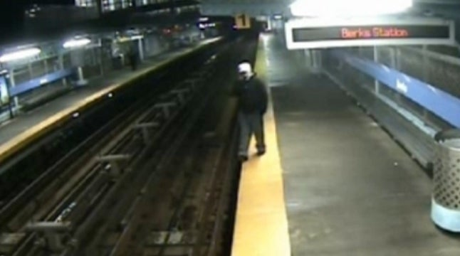 Cellphone Distraction Causes Man to Tumble Onto Train Tracks