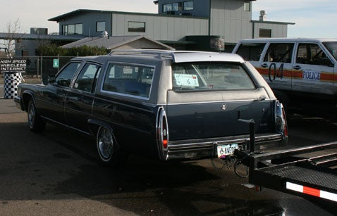 What Do You Do With A Crushed Mazdasaurus? Haul It Away With A Caddy Wagon!