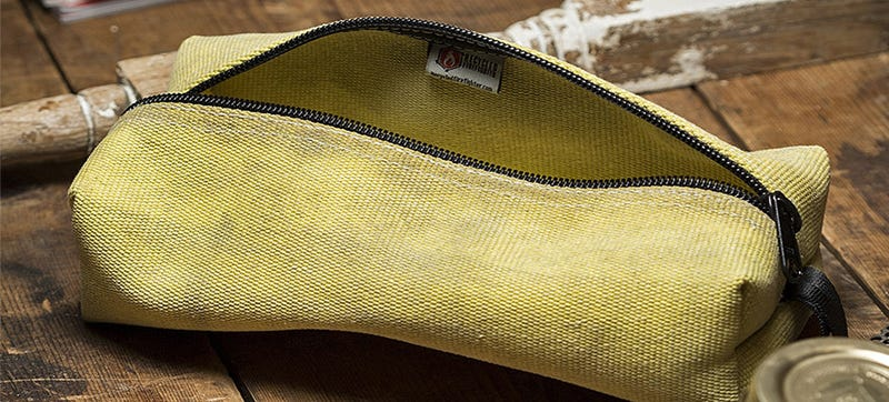 A Toiletries Bag Made From a Fire Hose Doesn't Mind Getting Wet