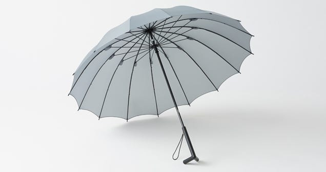 A Clever Standing Umbrella Drips Dry On Its Own Two Feet