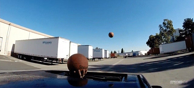 Man does spectacular trick shot through moonroof while driving a car