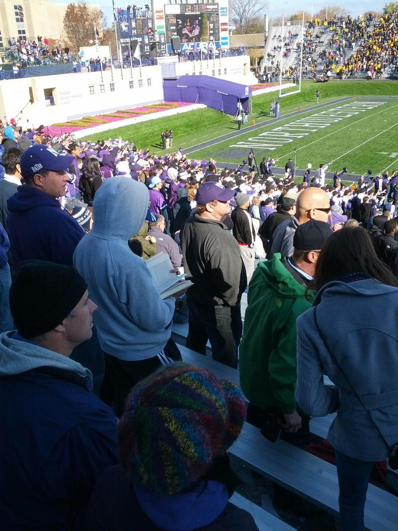 Here Is A Northwestern Student Reading At A Football Game, Perpetuating Stereotypes
