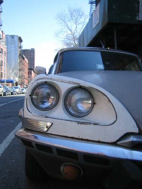 Citroën DS, Aston Martin Lagonda Down On The New York City Street