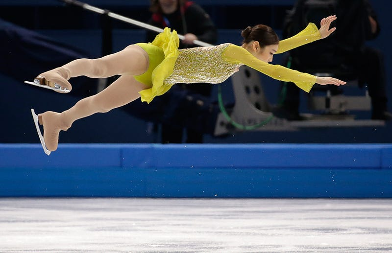 Amazing Images of Olympic Figure Skaters Defying Gravity