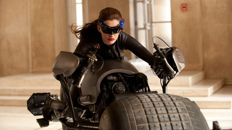 Here's Anne Hathaway as Catwoman riding Batman's Batpod
