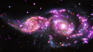 "Blaze of glory. NGC 2207 and IC 2163, two spiral galaxies in the process of merging, turn out to have an unusual number of ""ultraluminous X-ray sources"" according to the Chandra X-Ray Observatory. What's more, astronomers have found three sup"
