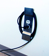 CordWrap Keeps Cords Off the Floor and Plugged In