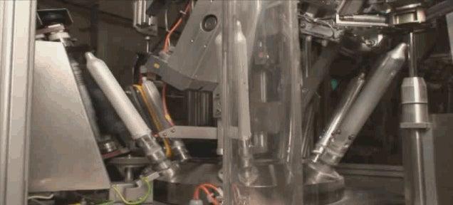 This mesmerizing machine rolls and unrolls condoms