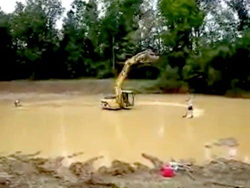 Redneck Waterskiing With a Caterpillar Excavator