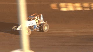 Watch A Sprint Car Disintegrate As It Nearly Flips Over The Fence