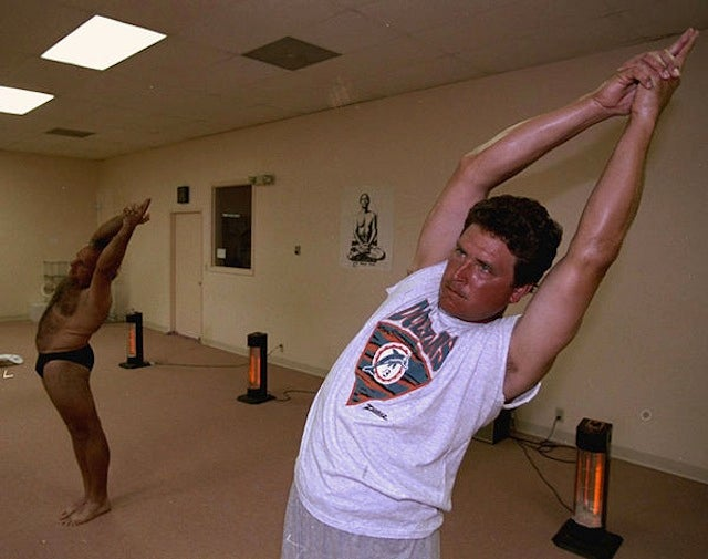 Here's An Old Photo Of Dan Marino Doing Yoga With Some Really Hairy Guy Who's Only Wearing A Speedo