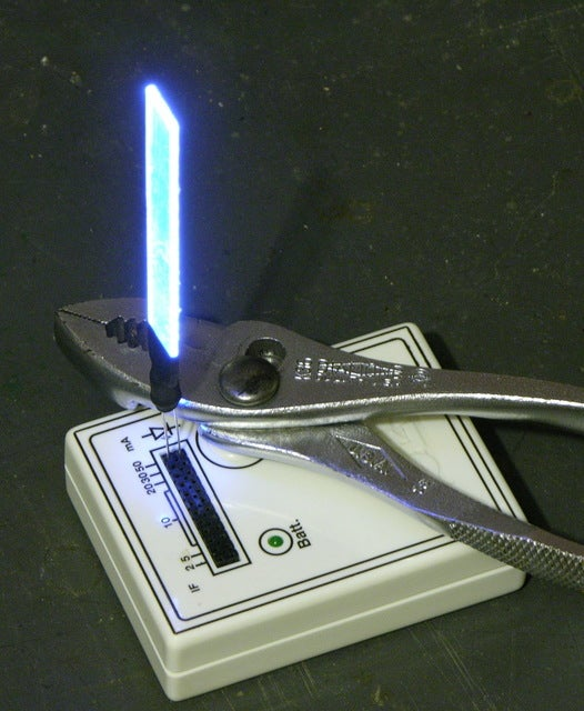 Turn Your Broken CD Case Shards Into Mini LED Light Sabers For Your Wall