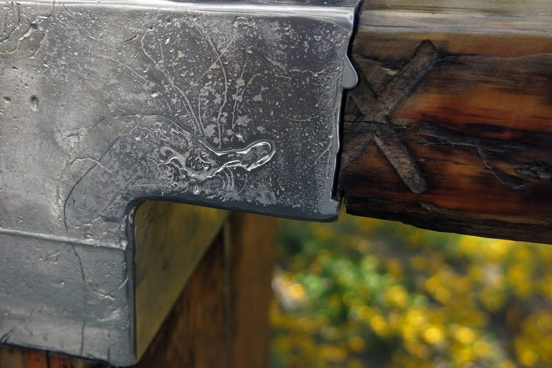 Casting Molten Metal On Wood With a Hungarian Design Master