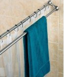 Use an extra shower rod to dry swimsuits and towels