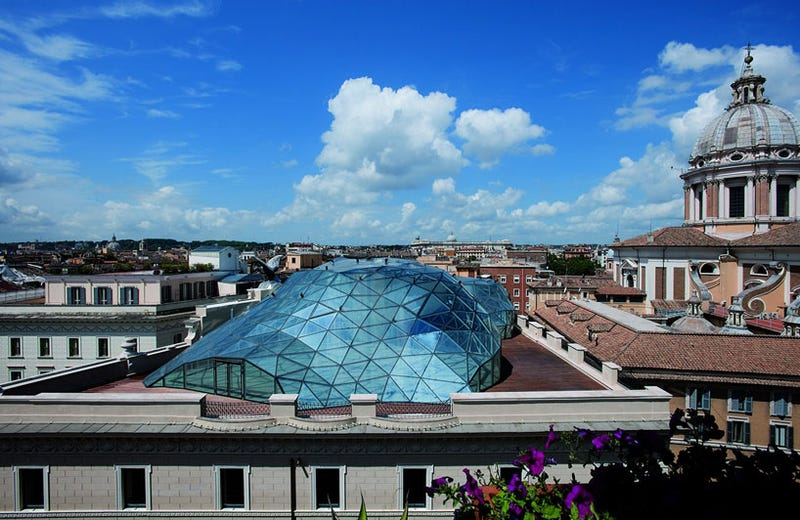 A Century-Old Roman Palazzo Grows a Faceted Glass-and-Steel Parasite