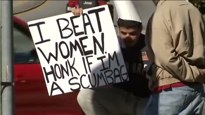 Woman-Beating Man Punished By Being Forced To Hold 'I Beat Women' Sign