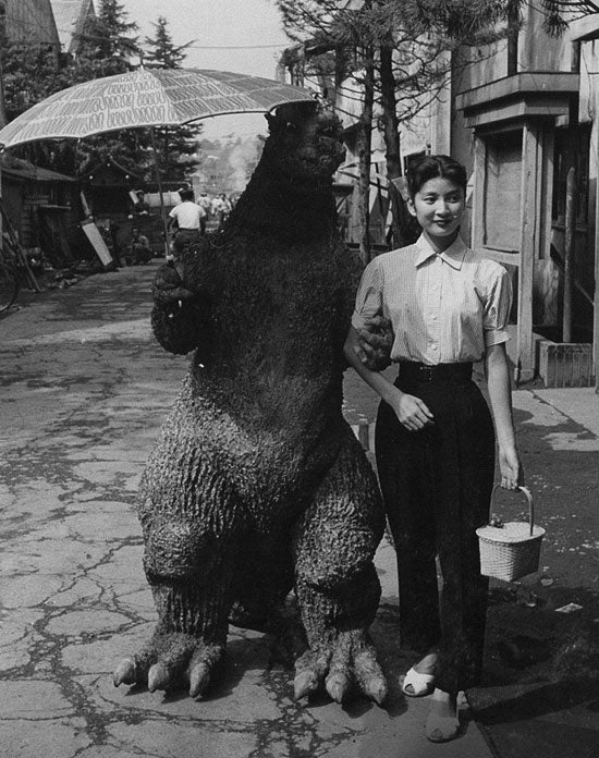 Concept Art Writing Prompt: Gentleman Godzilla goes out for a stroll